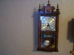 Stylish Day and Date 31day wind striking wall clock,reconditioned,tested,runs.