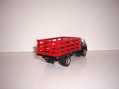 DCP FIRST GEAR 1/64 BLACK CAB RED STAKE SIDE GMC 6500 SINGLE AXLE STAKE TRUCK  2