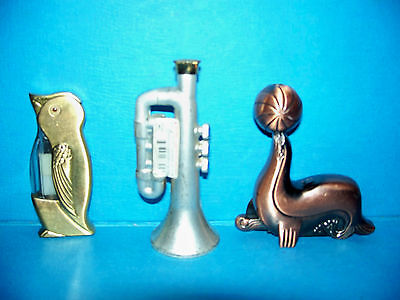Lot of 3 Metal Shaped Cigarette Lighters Penguin Seal Balancing Ball Trumpet