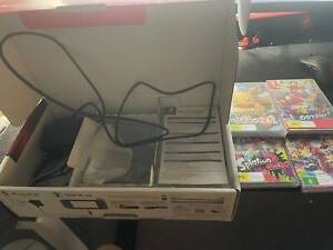 nearly new intendo switch with 4 games and case