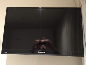 29 inch TV built in DVD player and wall bracket
