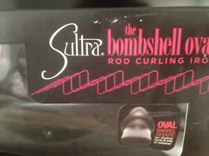 Oval curling iron