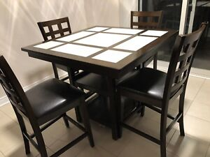 Pub-style dining table with 4 chairs