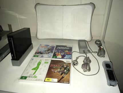 Black Wii with 4 games and accessories