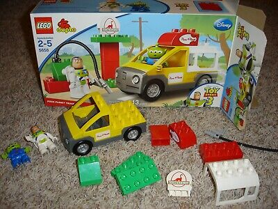 12 pc.Disney Pixar Toy Story 3 Pizza Planet Truck Lego Duplo set #5658 Buzz