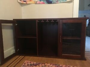 Cabinet with wine glass holders.