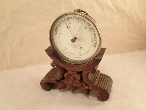Atqe J. T. TOOGOOD, UCKFIELD Brass Holometallic Barometer Carved Mahogany Stand