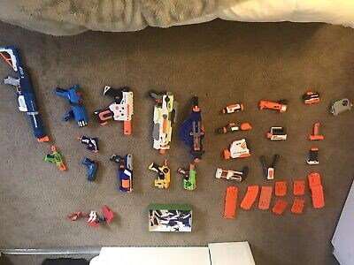 11 Nerf Guns 17 Attachments And Lots Of Darts