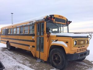 School bus converted to sled camp