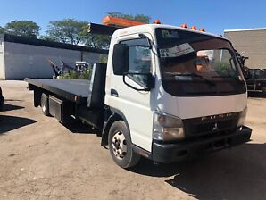 """2007 Mitsubishi Fuso  with steel 22"""" flatbed Towtruck"""