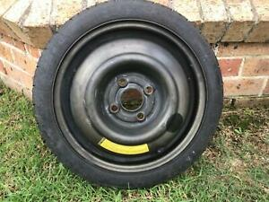 """Single 14"""" space saver wheel with 4x100 for small vehicles including"""