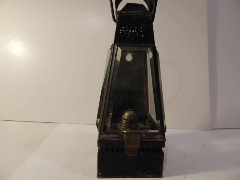 Antique metal and beveled glass oil lamp