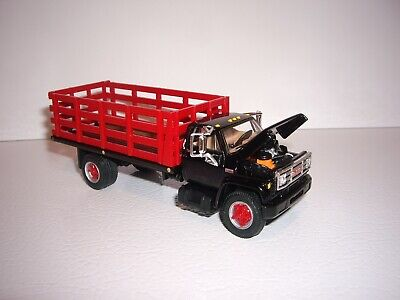 DCP FIRST GEAR 1/64 BLACK CAB RED STAKE SIDE GMC 6500 SINGLE AXLE STAKE TRUCK  3