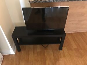 Samsung 28 inch tv plus ikea stand.