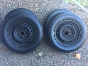 4 Studded Uniroyal TigerPaw tires and wheels