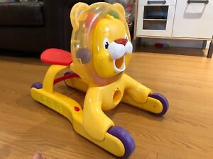 Fisher-Price ride on/walker lion with songs