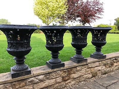Set of four cast iron urns - cast iron pierced and foliate planters