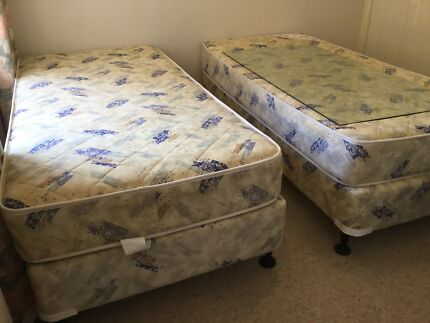 Two commercial quality single beds