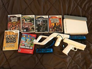 Wii console ft guitar hero and more