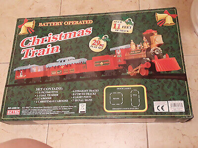 North Pole Junction Christmas Train 29 piece set. Battery operated.11ftof track