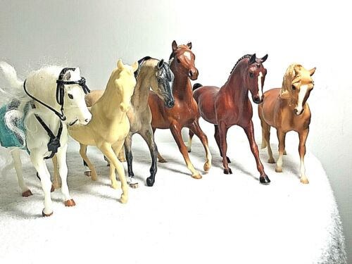 Six Breyer collectable horses