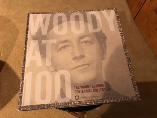 Woody at 100. Woody Guthrie Hardcover Book with a collection of songs on cd.