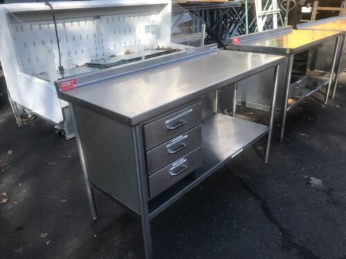 Used heavy duty restaurant table/cabinet.