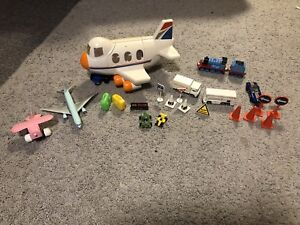 Various toy cars, truck, planes and accessories hand held