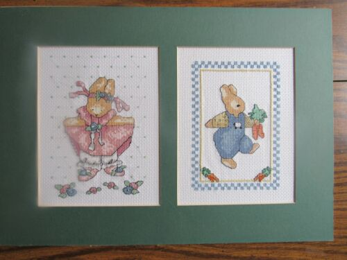 Completed cross stitch of two pictures of rabbits, cute, for 1 frame