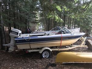 $3000 1987 Edsen Resorter boat with 60HP outboard motor