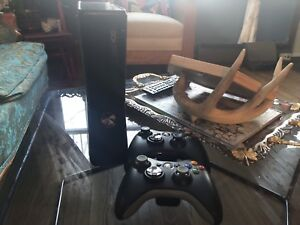 Xbox 360 with 2 controllers and 2 games