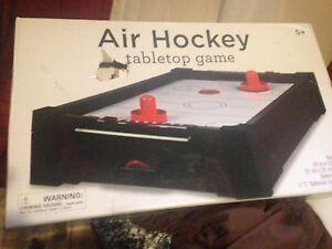 Table top air hockey table