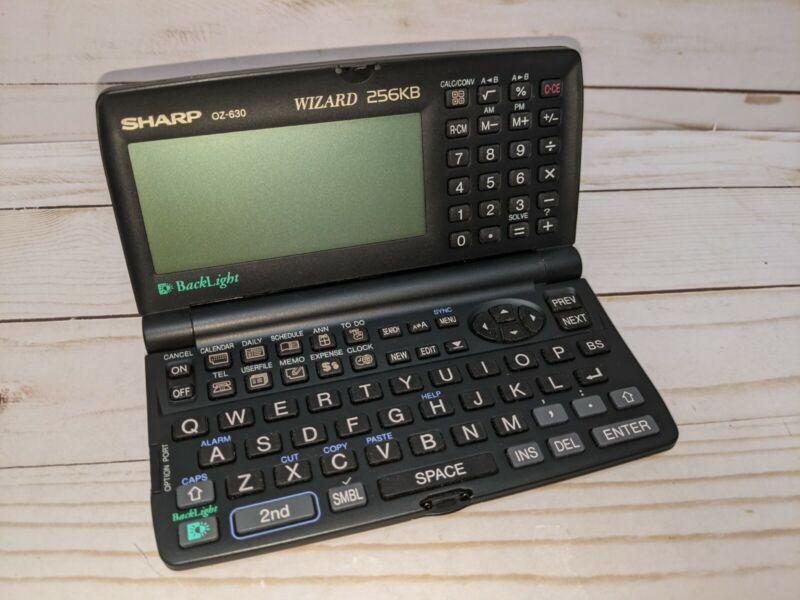 Vintage Sharp Wizard Personal Information Data Organizer works OZ-630