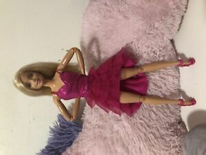 Made to move Barbie doll and clothes