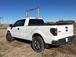 Ford f150 4wd LOW Kms (female driven)