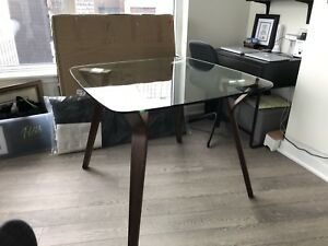 Beautiful mid-century modern glass top dining table