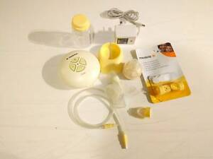 Medela Swing Breast Pump like new with brand new accessories