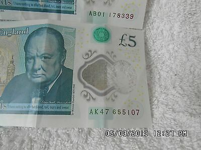 Two Polymer £5 Notes AK47 and AB01.
