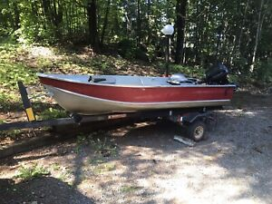 Aluminum boat with 9.9 evinrude engine and trailer
