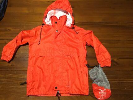 Kids' Rainbird stow-away rain jacket, size XS (red)
