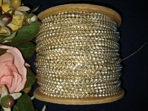 VINTAGE SPOOL OF TINY FACETED BEADING~BEADWORK~SILVER COATED TRIM~72 YDS APPROX.