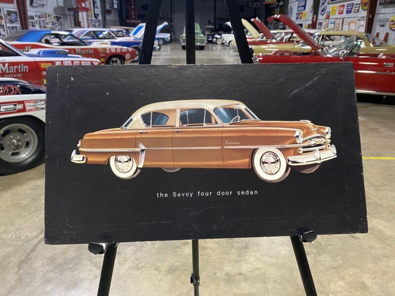 "1954 Plymouth Dealer Promotional Card ""The Savoy four door sedan"""