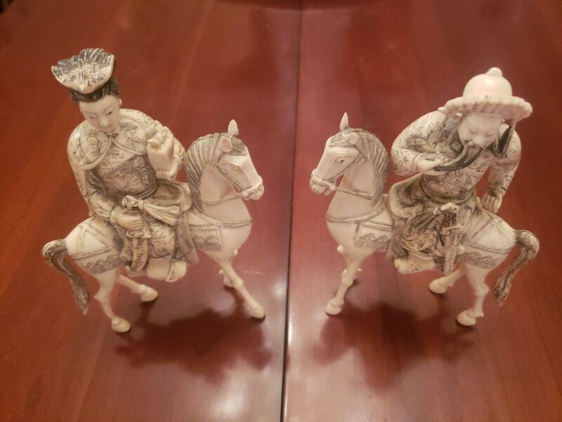 HAND CARVED EMPEROR AND EMPRESS ON HORSEBACK.