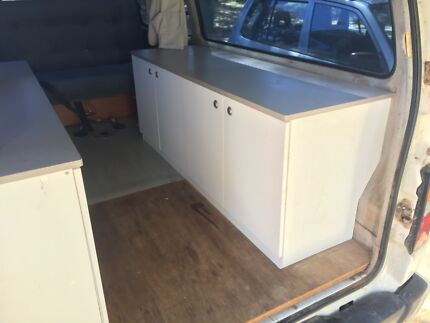 Cupboards for campervan/caravan fit over wheel arches