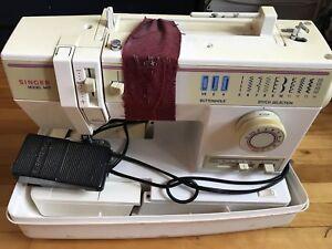 Machine à coudre Signer -40$