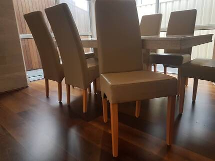 8 Leather Dining Chairs (Almost new)