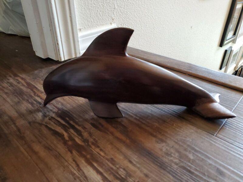 Beautiful hang carved vintage dark wood dolphin