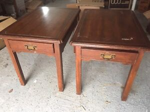 A pair of wood side tables