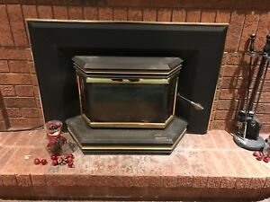 Complete Osburn fireplace insert with liner for sale