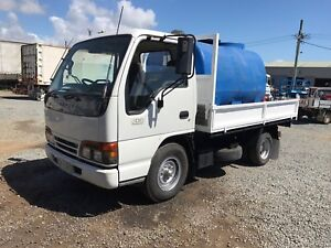 Isuzu NKR200 tipper & slide in water tank  Upper Coomera Gold Coast North Preview